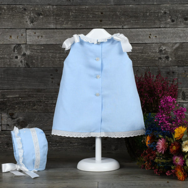 Vestido de lino con entredoses de tira bordada